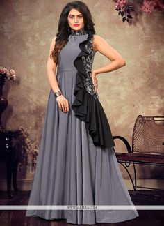Be the center of attention with this grey fancy fabric floor length gown. The fancy work appears chic and great for any occasion. (Slight variation in color, fabric & work is possible. Latest Party Wear Gown, Party Wear Gowns Online, Party Wear Long Gowns, Designer Party Wear Dresses, Kurti Designs Party Wear, Designer Gowns, Dress Designs, Indian Party Wear, Indian Bridal Wear