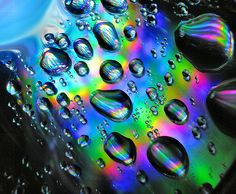 iridescent | mother-of-pearl | gleaming | shimmering | metallic rainbow | shine | anodized | holographic | oil slick | peacock | iridescence | Iridescent Droplets by Anachronist84.deviantart.com on @deviantART