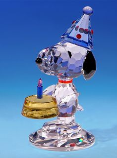 "Snoopy crystal figurine with birthday cake - ""A Birthday Beagle"". PEANUTS © 2011 PEANUTS Worldwide LLC. www.CrystalWorld.com"