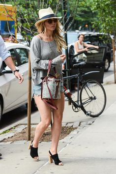 Jennifer Lawrence stepped out for two separate outings in NYC this week. On Wednesday, she was spotted looking cute and summery in cutoff shorts while walking in SoHo (with her superhot bodyguard not far behind). See more pics when you click!