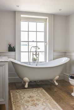 The slipper bath, from Tenterden Bathroom Shop, has views through the sash window over the horse paddocks. Wooden panelling was added on lower walls to give a classical feel. Bathroom Shop, Wooden Bathroom, Boho Bathroom, Bathroom Storage, Small Bathroom, Bathroom Ideas, French Bathroom Decor, Neutral Bathroom, Family Bathroom