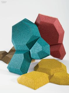 Molded from a composite of recycled materials, these faceted forms are sound-absorbing and insulating as well as antimicrobial and non-allergenic.