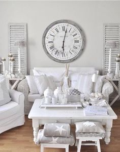 Small rooms look great in white as it makes them look bigger, white modern living rooms