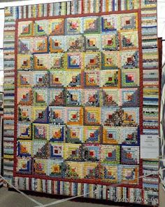 Love this scrappy log cabin quilt with a great border.  Quilt by Charlotte Alexander, English, IN.