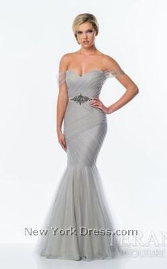Showcase your incredible curves in this exquisitely stylish Terani 151P0107 Prom creation! Banded patterns of delicate, gauzy material help to strike the perfect