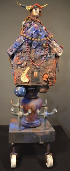 "Far off the Chisholm Trail (for Devils), 2006-13, 26"" x 11 1/2"" x 8 1/2"" Mixed media, wood, Mardi Gras beads, African seed beads, cement, clay, encaustic, 22K gold leaf, porcelain wheels, paint, powdered pigment,etc."