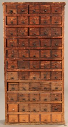 Pine hanging apothecary cabinet with 55 drawers and metal pulls. Nailed construction with traces of old varnish on front. Provenance: estate of A. Unique Home Decor, Home Decor Styles, Home Decor Items, Home Decor Accessories, Cheap Home Decor, Printer Cabinet, Apothecary Cabinet, Antique Cabinets, Wooden Cabinets