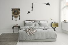 So stylish! Looking for similar bedding (or solid wood low beds)? Try http://www.naturalbedcompany.co.uk/shop/bedding/linen-bedding/