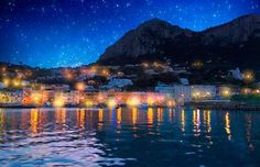 Reflected lights and shimmering stars dance upon the waters of this ancient pristine resort island.