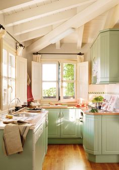 Cute cottage kitchen ~ beautiful shade of green in this light-filled tiny kitchen.