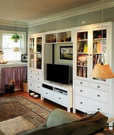 Eclectic-Living-Room-With-HEMNES-Glass-Door-Cabinet-With-4-Drawers-Coffee-Table-And-Sofa-Table-Chair