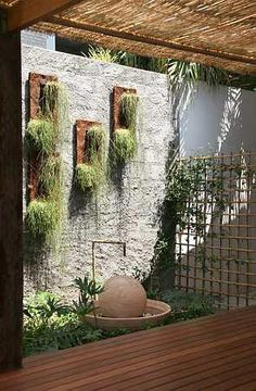This looks like a peaceful garden! Love the bamboo trellis for the vines in the background.