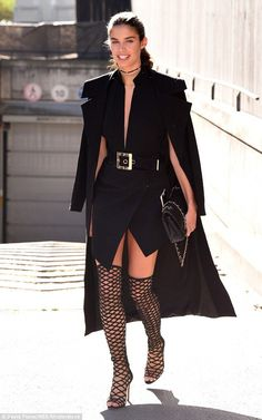 Parisian elegance: In true fashionista form, Sara Sampaio strategically draped a long structured coat on her shoulders, while toting a matching black handbag Sara Sampaio, Fashion Week Paris, Black Women Fashion, Girl Fashion, Womens Fashion, Steampunk Fashion, Gothic Fashion, Female Models, Women Models