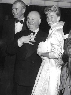 James Stewart, Alfred Hitchcock and Doris Day at the Hollywood premiere of 'The Man Who Knew Too Much' 1956.