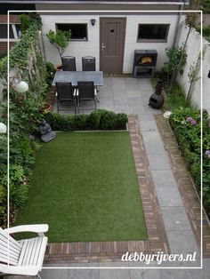Small backyard garden with bluestone tiles, artificial grass and lots of evergre. Small backyard g Small Back Gardens, Small Backyard Gardens, Backyard Patio Designs, Small Backyard Landscaping, Outdoor Gardens, Landscaping Ideas, Backyard Pergola, Small Patio, Pergola Ideas