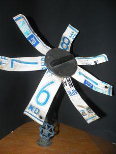 Lisence plate flower found materials sculpture. $86.00, via Etsy.