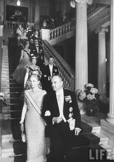 Prince Rainier III of Monaco (R) with Princess Grace (L), at the wedding in Athens of Princess Sophie and Prince Juan Carlos of Spain.  Location:Athens, Greece  Date taken:May 1962  Photographer:Hank Walker