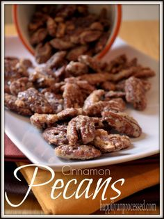 Candied pecans that are coated in a sugar and cinnamon glaze and slow roasted to bring out the nutty flavor!    Perfect for the non chocolate holiday treat!