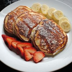 Three Plain Buttermilk Pancakes with Strawberries or Bananas.