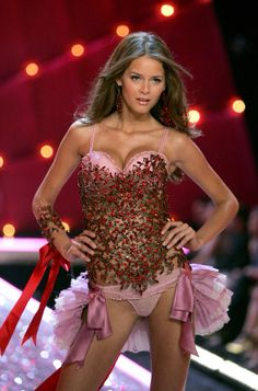 ca95bd9d453 Flavia De Oliveira Pictures - Victoria's Secret Fashion Show 2006 - Runway  - Zimbio. I love the tiny ruffles coming from the waist, and I love the  color of ...