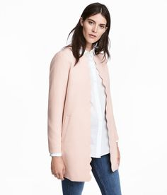 Check this out! Short coat in a thick, woven fabric with pockets at front. Opening with scalloped trim at front. Lined. - Visit hm.com to see more.