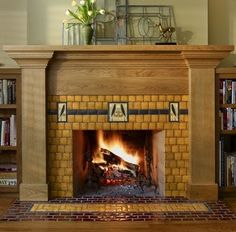fireplace tile, Motawi Tile, decorative tiles on a dark ribbon, with a field of smaller square tiles