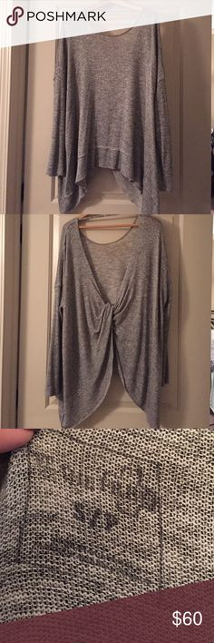 Free People Sweater. Small Super super cute Free people bought at Buckle. Open crisscrossing back. Heathers grey. Runs big. No trades please Buckle Tops Blouses
