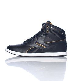 low priced 2f9a3 3bfc2 REEBOK Mid top women s sneaker Metallic studs detail Lace up closure Padded  tongue with REEBOK logo