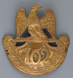 PLAQUE DE SHAKO D'OFFICIER DU 102ème RÉGIMENT D'INFANTERIE DE LIGNE, MODÈLE 1812, PREMIER EMPIRE.