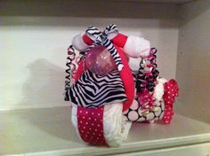 Zebra Print & Hot Pink Tricycle Diaper Cake With Personalized Bib and Burp Coth. $58.00, via Etsy.