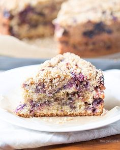 This Blueberry Sour Cream Coffee Cake is filled with blueberries and pecan and toasted coconut streusel. Make a day ahead of time for best results.