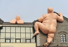 50-foot naked Buddhas on a restaurant in China's Shangdong province #DailyMail