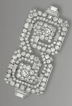 DIAMOND BROOCH, CARTIER, CIRCA 1925  The geometric plaque of meander inspiration set throughout with circular- and square-cut and baguette diamonds, mounted in platinum, signed Cartier, made in France and numbered, French assay marks.
