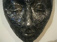 Ceramic mask in Faux Forged Metal - interesting wall decor