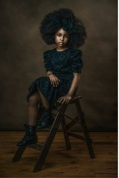 Full body studio portrait of an Afro-American girl. Posing ideas for children photography. For more visit the website.