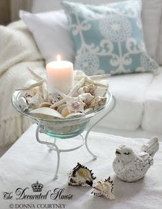 glass bowl with pillar candle and shells
