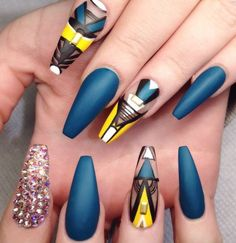 Teal blue yellow rhinestone matte nail design