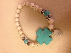 """White magnesite, blue magnesite , pewter stretchy bracelet design. Added my touch by adding my """"believe"""" tag as part of the cross design."""