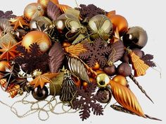 $39.99-$79.99 125-Piece Club Pack of Shatterproof Brown Copper Gold Tone Christmas Ornaments - Chocolate Brown Color Theme Shatterproof Christmas Ornament Club Pack Item #N512515 125-piece set  This amazing array of ornaments is done in dazzling brown, copper and gold tones with a mixture of matte, shiny and glitter finishes. This special club pack will allow you to build your collection quickly ...