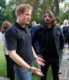 Two of my favorites....but I love Dave more!! Foo Fighters Dave Grohl Prince Harry 9/9/14 Getty Images Collection photo: Chris Jackson