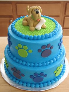Puppy Dog Birthday Cakes | Buttercream covered cake with fondant puppy topper and paws.