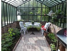 Garden Shed: Using It as a Workshop or Craft Room Outdoor Spaces, Outdoor Living, Outdoor Decor, What Is A Conservatory, Greenhouse Shed, Up House, Garden Structures, Glass House, Garden Planning