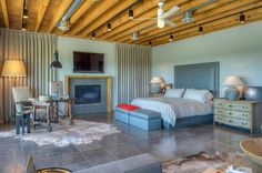 This home and bedroom takes on a modern approach to your typical log cabin. This bedroom is spacious and offers an abundance of amenities like a built-in fireplace. Huntsville, TX Coldwell Banker United, Realtors