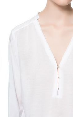 White POLO NECK SHIRT from Zara.  I really like the neckline on this.  $59.90