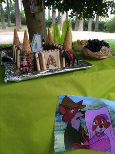 Anniversaire sur le theme robin des bois avec un gâteau château bien sûr