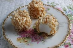 Coat marshmallows with ice cream topping and roll in crisp cereal for a quick and easy Caramel Crisp Marshmallows candy recipe perfect for Christmas or anytime.