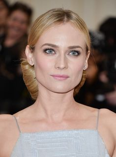 Diane Kruger pulled her hair back into an elegant chignon on the 2014 Met Gala red carpet. This style would look lovely with a veil tucked in!