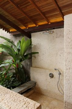 It would be awesome if we could integrate a planter box into our bathroom, to give it this lovely tropical feel