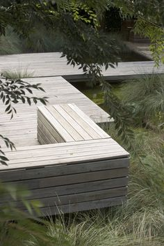 Timber and ornamental grasses.Garden by Peter Fudge
