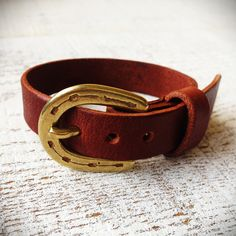 This is a bracelet of brass and leather I made. Horseshoe I heard good luck!